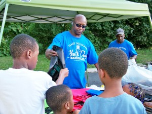 Volunteer distributes backpacks