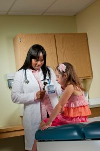 "Olamide Ajagbe MD takes care of Mia, 5, who was at Upstate Golisano After Hours Care because her ""ear hurted."" Photo by Robert Mescavage."