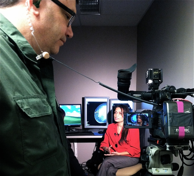 Photographer Jim Kearns and reporter Leigh Isaacson from NewsChannel 9 interview Dr. Deepa Masrani, director of women's imaging at Upstate. Photo by Kathleen Paice Froio.
