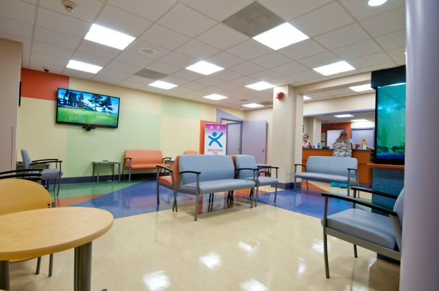 The center is open evenings and weekends. Its colorful furnishings are based on the Upstate Golisano Children's Hospital. There are lots of comfortable chairs, and a big TV, a fish tank and fun-house style mirrors that provide entertainment. Photo by Robert Mescavage.