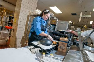 Karoline Simpson prepares food trays for patients.