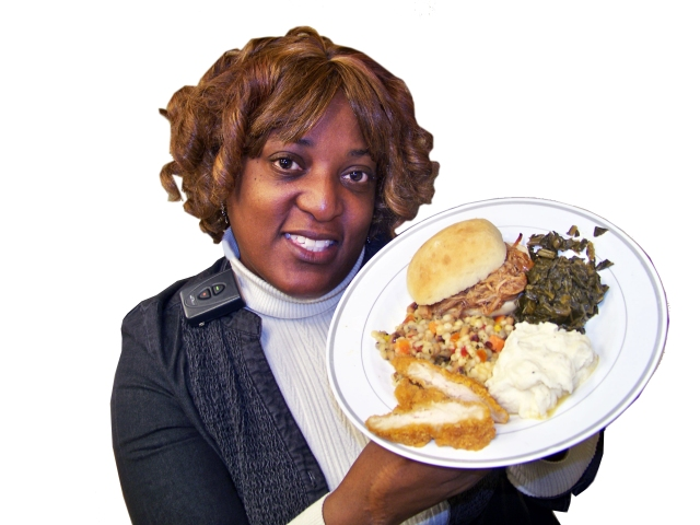 Upstate social worker Chevelle Jones-Moore gives a preview of the soul food lunch that will be served at the Feb. 6 Black History month event.