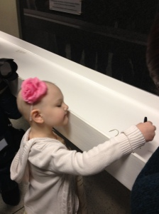 6-year-old Marrah Smith was one of the first to add her name to the beam.