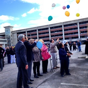 Participants release balloons during the ceremony. Photo by Darcy DiBiase.