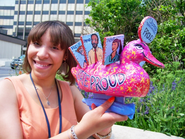 "Kristin Thompson holds the  ""Proud To Know Upstate"" duck, which will be part of the Duck Race To End Racism Saturday, June 8 at Syracuse's  Inner Harbor."