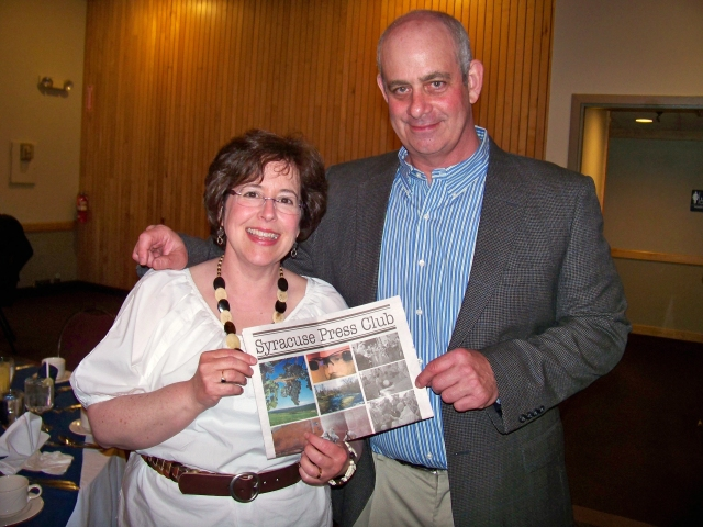 Photographer Susan Kahn and humor writer Jeff Kramer pose at the Syracuse Press Club awards banquet Saturday night.