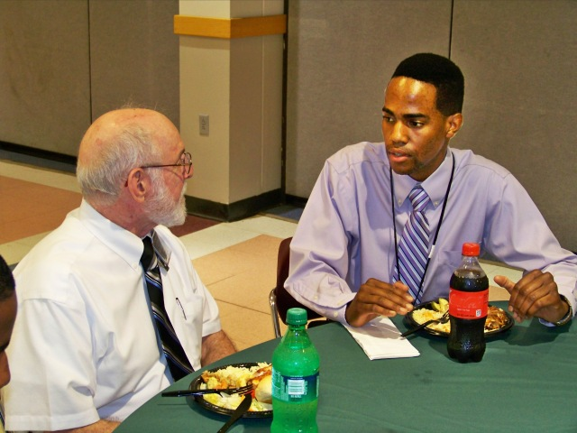 "Intern Lenoi Carter talks with his mentor, Gerald Connor, at the welcome luncheon for the summer 2013 Synergy/Mercy Works summer internship program. Connor, a radiation safety officer at Upstate, says, ""Every medical center needs a medical physicist and a radiation safety officer. Part of the reason I am a mentor is to increase awareness of the field. These are invaluable careers that promise to have job openings in the future."""