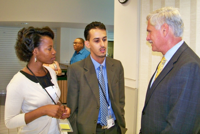 Interns Frances Day and Mohammad Al-Ali talk with Upstate president Dr. David R. Smith, MD at  the welcome luncheon for the summer 2013 Synergy/Mercy Works summer internship program.