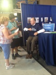 Dr. Mark Polhemus talks to visitors about shingles.  There's a clinical trial for that!