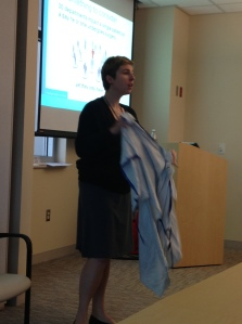"Nurse manager Becky Mesmer uses a hospital gown as a prop during ""I Am The Patient Experience"" training on Thursday, Aug. 1."