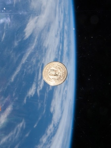 The medallion floats inside the International Space Station during its 146-day stay.