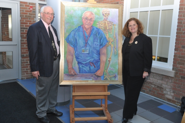 Professor Barry Berg, PhD with artist, Susan Keeter at the portrait unveiling.