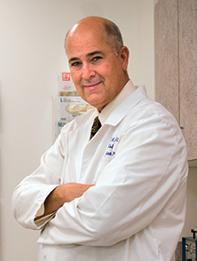 Dr. David Halleran in his office at Colon Rectal Associates of Central New York. Photo by Bob Mescavage.