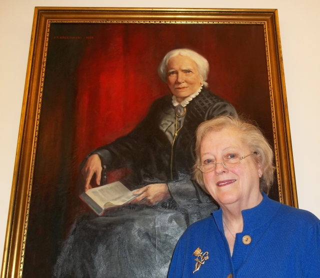 2014: Patricia Numann MD, first woman surgeon in Syracuse, with Upstate's portrait of Elizabeth Blackwell.