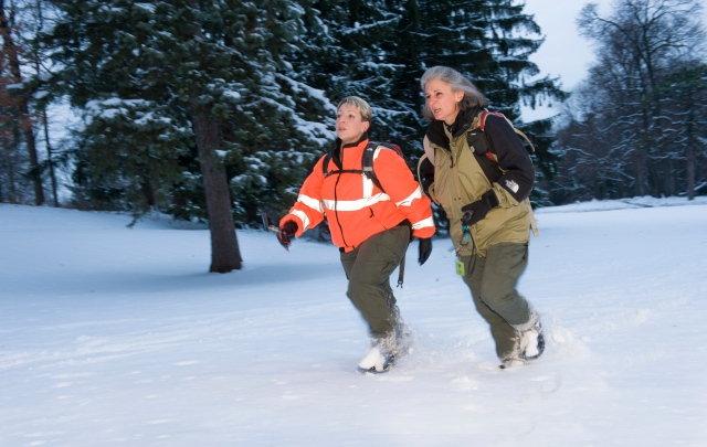 Renae Rokicki and Ann Salvagni in the woods.