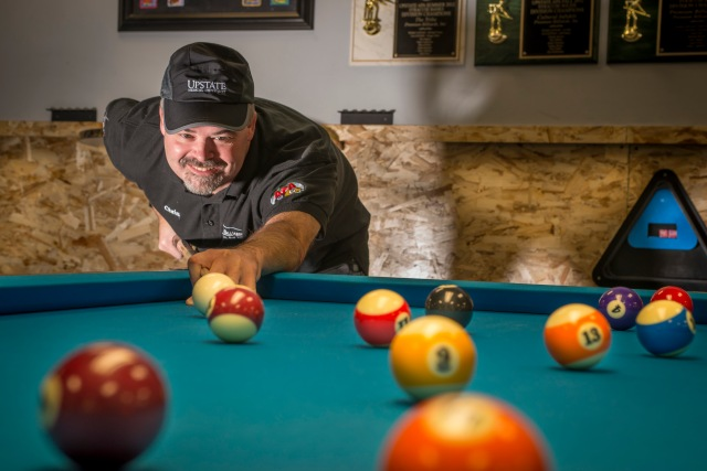 Like many billiards enthusiasts, Christopher Sanders has no pool table in his home, preferring instead to frequent a pool hall. His favorite is Premium Billiards, 228 Chapel Dr., Syracuse, which sponsors him. During the day he is an EEG technician at Upstate University Hospital.