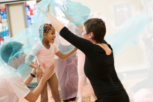 Upstate patient Miracle Thompson, 5, dances with Jowonio occupational therapist Lisa Neville, and is supported by Nottingham High School student and dancer, Bela Harris. The ballet program is sponsored by the Madeline Cote fund. Photo by Susan Kahn.