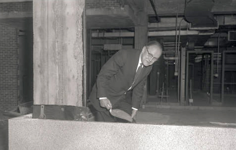 "Carlyle ""Jake"" Jacobsen laying the cornerstone for Upstate's downtown hospital, 1963"