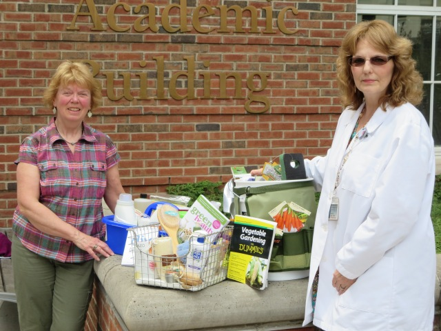 "Think Green Fair committee members Nancy Schreher, left, and Patricia Duffy, with the three ""green"" baskets that will be given away at Thursday's Think Green Fair."