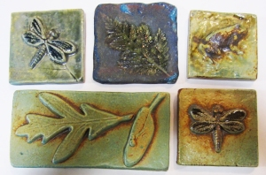 Ceramic tiles by Margie Hughto. Similar nature-themed wall sculptures will be in the new cancer center.