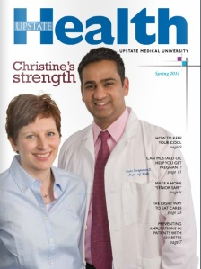 Christine shares the cover of Upstate Health with her oncologist, Dr. Sam Benjamin.