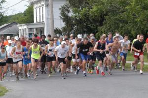 Chris Loughlin in in a blue tank to the far right in this Yellow Brick Road Run picture.