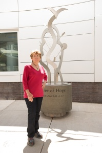 The artist, Steinfeld with her sculpture, which was installed July 9. Photo by Susan Kahn.