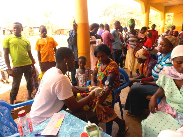 Upstate respiratory therapy student Adlin Noel takes blood pressure at a clinic in Ghana.
