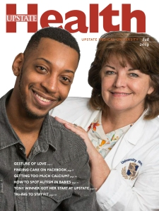Kidney donor Brandon Hudson appears on the cover of Upstate Health magazine with living donor transplant coordinator Ellen Havens.