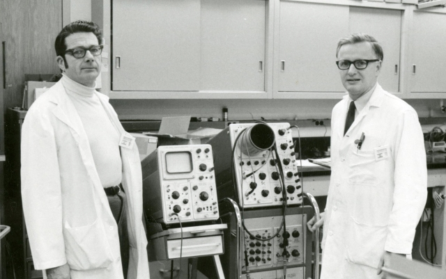John McAfee MD, chairman of radiology and radiological sciences, 1965-1989, and Robert Richardson PhD, associate professor of radiology,  in the nuclear medicine lab at Upstate University Hospital, circa 1970.