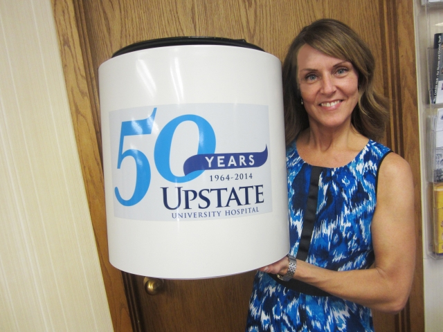 Upstate employee Jennifer Congel holds a time capsule which will buried at Upstate University Hospital.
