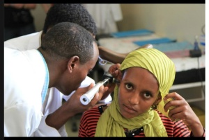 Medical students in the Ethiopian city of Awassa examine a patient using an otoscope donated by Drs. Rick Kelley and Sam Woods, after the Upstate physicians demonstrated how to conduct the exam.