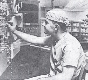 Donell Bacon worked on this  electronic console in the operating room. Pictured is his colleague,  Larry George. Syracuse Newspapers, 9/5/65.