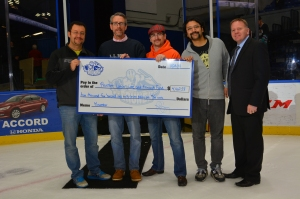 Participating in the check presentation at the hockey game are, from left, Upstate's Gennady Bratslavsky, MD, Michael Lacombe, MD, Dmitriy Nikolovsky, MD and Srinivas Vourganti, MD.  Joining them is Jim Sarosy of the Syracuse Crunch.
