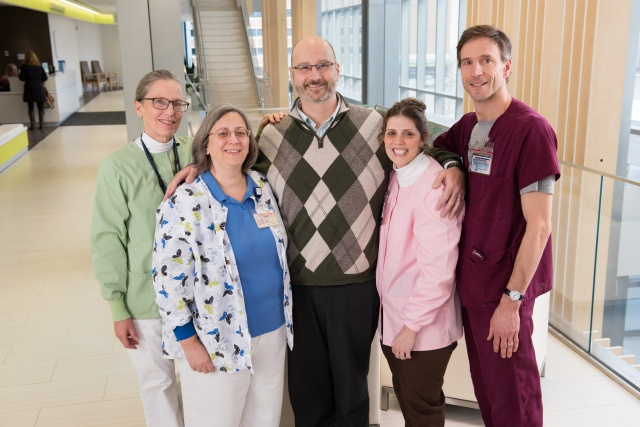 Author David Lankes, PhD, center, with his oncology nurses, from left to right, Carolyn Stafford, Heidi See, Cyndy Carr and Kevin O'Keefe.