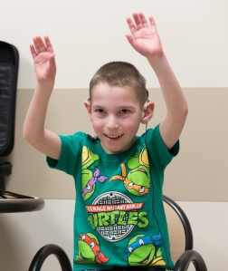 Mason Drake at the moment he heard sound, thanks to cochlear implants. Photo by Kathleen Paice Froio.