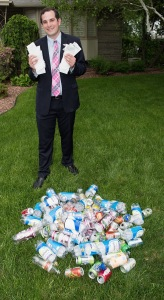 Laurence Segal shows receipts from the bottles and cans he has redeemed to help cancer research. (PHOT OBY SUSAN KAHN)