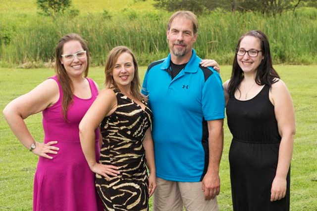David Hoistion, 46, weighs 185 pounds, down from 345 pounds before his surgery in April 2012. His wife, Tanya Hoistion (second from left) had surgery in October 2012, dropping to 140 pounds from 265 pounds. His two daughters had surgery on the same day in October 2014. Nicole Hoistion, 25, (left) has dropped to 210 pounds from 325, and Cherica, 20, (right) has dropped to 170 pounds from 272 pounds.
