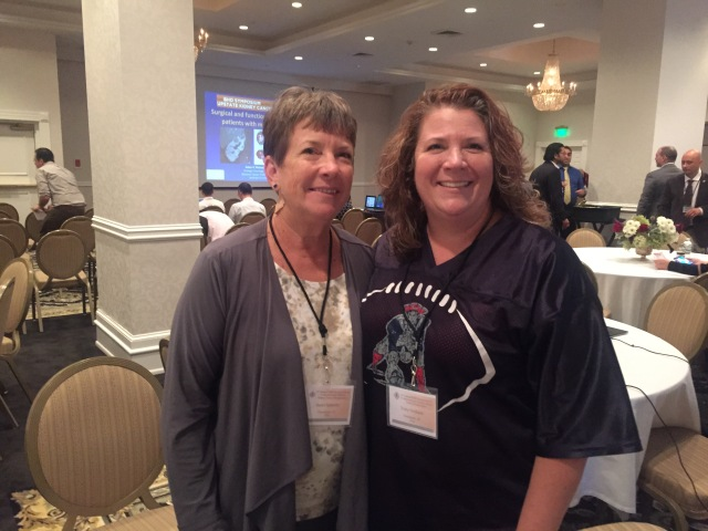 Tracy Graham, left, of Grandview, Ind., and her mom, Janet, attend the 6th BHD Symposium and First International Kidney Cancer Symposium sponsored by Upstate Medical University. In 2013 Tracy was diagnosed with BHD (Birt-Hogg-Dube) Syndrome, a rare hereditary condition associated with benign skin tumors, lung cysts, and an increased risk of both benign kidney tumors and kidney cancer. The symposium enabled Tracy and Janet to learn more about this rare disorder as they met with researchers from around the world. Tracy wants to clarify that her Patriots sweatshirt represents her son's high school football team -- not the New England Patriots.