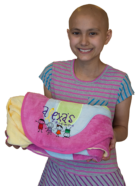 Alexa Bolton, 10, shows one of the fluffy character towels she distributes to pediatric cancer patients at Upstate Golisano Children's Hospital through a fund she established. (PHOTO BY KATHLEEN PAICE FROIO)