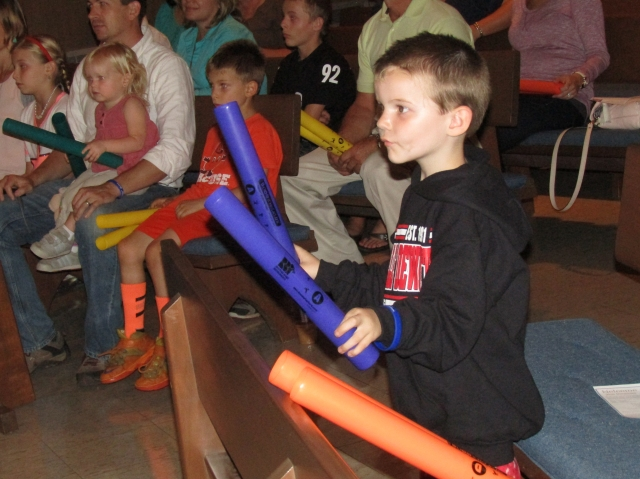 Zachary Cottell, 4, responds to a musical prompt, or rhythm seed, by drumming with purple plastic tubes (boom whackers) at an interactive concert for people affected by autism. The concert was part of a two-day autism awareness event hosted by Upstate's Margaret L. Williams Developmental Evaluation Center.