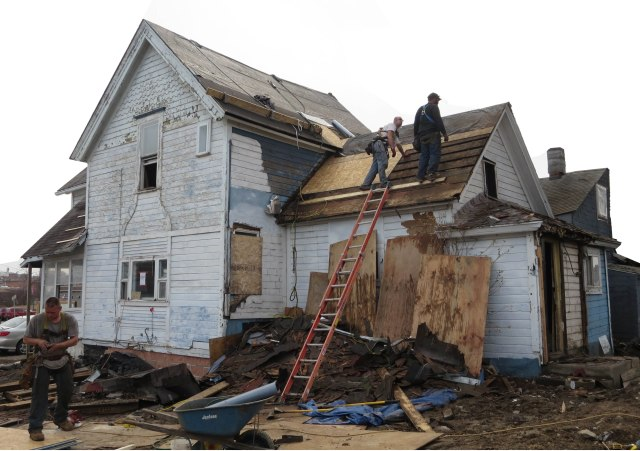 The house at 142 Granger St., Syracuse, near the Rescue Mission, as it looked while undergoing renovations. (PHOTO BY Jim McKEEVER)