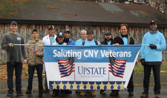 Among the military veterans with ties to Upstate who took part in the Central New York Veterans Parade & Expo at the New York State Fairgrounds on Saturday are (from left, with their service branch): Andrew Brown (College of Health Professions, class of 2017, Marines); Kevin Jacobs (SUNY College of Environmental Science and Forestry student who served in the Marines with Brown); Elton Garvin (CHP, Army); husband and wife Yetta (Sleep Center, Air Force) and Elliott J. Williams (Patient Access Services, Air Force); Ted Spadotto (Physical Plant, Army); Le'Nard Chisholm (Payroll, Army); T.J. Yount, (CHP class of 2009 alum, Army); Joseph Donovan (Physical Plant, not a veteran; he came to show support) and Willie White (Central Equipment, Army). (PHOTO BY SUSAN KEETER)