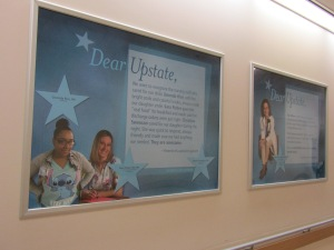 A hallway on the second floor of the downtown hospital has posters of employees who have been praised, in writing, by patients and family members.