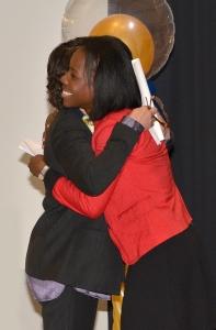 Upstate President Danielle Laraque-Arena, MD, hugs Kethia