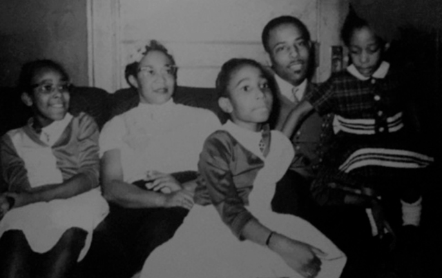 Maxine Thompson (then Summerhill), center, with her parents and sisters in their Syracuse home in the early 1960s.