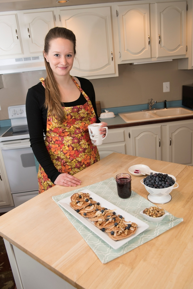 Killian Cardinali in her kitchen with protein pancakes and blueberry sauce. (PHOTO BY SUSAN KAHN)