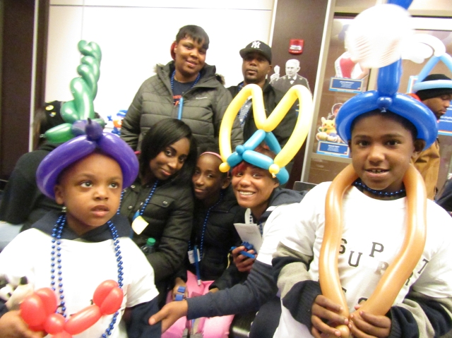 Diablo, at left, has autism. He is pictured with his family at the Blue Lights for Autism celebration, hosted by Upstate's Margaret L. Williams Developmental Evaluation Center and the CNY Autism Association of America