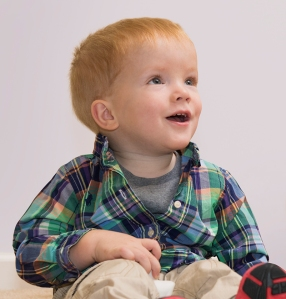 Mason Campbell, 2, of Minoa, had an operation before he was born to help lessen nerve damage from spina bifida. (PHOTO BY SUSAN KAHN)