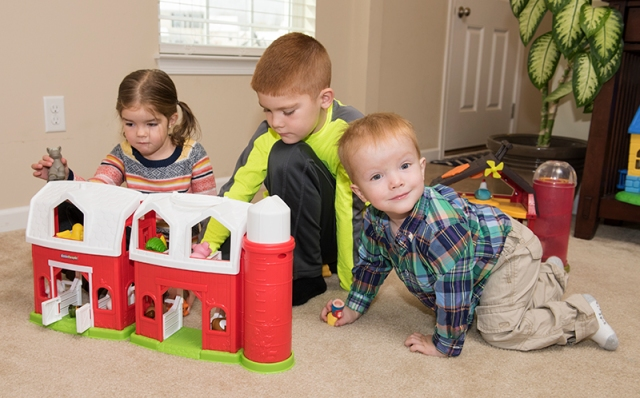 Mason at home with his sister, Ali, 4, and his brother, Christopher, 7. (PHOTO BY SUSAN KAHN)